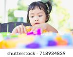 little girl playing with... | Shutterstock . vector #718934839