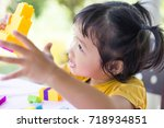 little girl playing with... | Shutterstock . vector #718934851