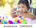little girl playing with... | Shutterstock . vector #718935319