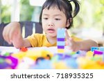 little girl playing with... | Shutterstock . vector #718935325