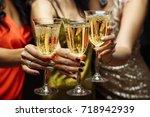 women's hands with glasses of... | Shutterstock . vector #718942939