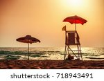 sunrise with life guard station ... | Shutterstock . vector #718943491