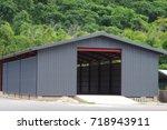new building  warehouse. | Shutterstock . vector #718943911