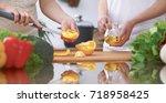 close up of four human hands... | Shutterstock . vector #718958425