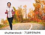 mature asian woman running... | Shutterstock . vector #718959694