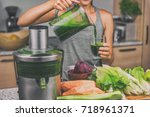 woman juicing making green... | Shutterstock . vector #718961371