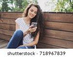 happy beautiful girl using... | Shutterstock . vector #718967839