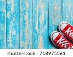 Red Sneakers On Wooden...