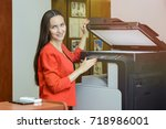 woman in red business suit and... | Shutterstock . vector #718986001
