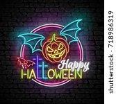 happy halloween greeting card... | Shutterstock .eps vector #718986319
