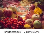 apple cider with apples and... | Shutterstock . vector #718989691
