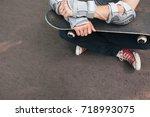 professional skater sitting... | Shutterstock . vector #718993075