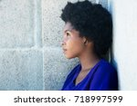 thoughtful african american... | Shutterstock . vector #718997599