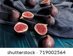 figs on blue wooden table... | Shutterstock . vector #719002564