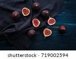 fresh figs on dark background ... | Shutterstock . vector #719002594