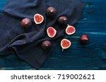 fresh figs on dark background ... | Shutterstock . vector #719002621