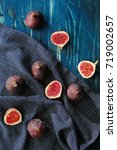 figs on blue wooden table... | Shutterstock . vector #719002657