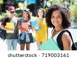 beautiful african american... | Shutterstock . vector #719003161