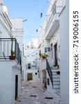alleyway. noci. puglia. italy. | Shutterstock . vector #719006155