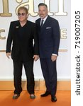 Small photo of LONDON - SEP 18, 2017: Sir Elton John and David Furnish attends the Kingsman: The Golden Circle World Premiere at Odeon Leicester Square