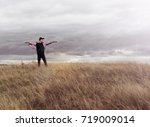 man who feels free  looking at...   Shutterstock . vector #719009014