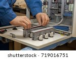 hands of electrician with... | Shutterstock . vector #719016751