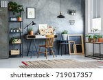 classic chair at white desk... | Shutterstock . vector #719017357