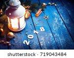 burning lantern and christmas...   Shutterstock . vector #719043484