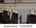 metal profile beam in packs at... | Shutterstock . vector #719046595