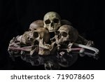 the human skull and pile of... | Shutterstock . vector #719078605