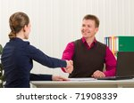 hands shake between two successful business people: man and woman at office place - stock photo