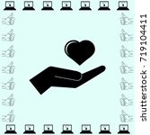 heart in the hand icon  love... | Shutterstock .eps vector #719104411