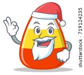 santa candy corn character... | Shutterstock .eps vector #719124235