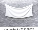 cloth banner hanging on brick... | Shutterstock . vector #719130895