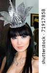 Small photo of ULAN-UDE, RUSSIA - MARCH 25: A model wears a fancy metal crown in ethnic style at the City Maecenas Ball on March, 25, 2009 in Ulan-Ude, Buryatia, Russia.