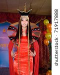 Small photo of ULAN-UDE, RUSSIA - MARCH 25: A model wears a fancy dress in Mongolian ethnic style at the City Maecenas Ball on March, 25, 2009 in Ulan-Ude, Buryatia, Russia.