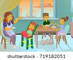 nanny in the kitchen is feeding ... | Shutterstock .eps vector #719182051