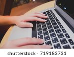 close up image of a hand typing ... | Shutterstock . vector #719183731