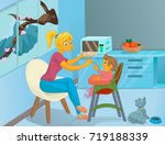 nanny in the kitchen is feeding ... | Shutterstock .eps vector #719188339