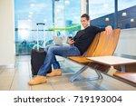 man using mobile phone in...   Shutterstock . vector #719193004
