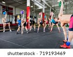 instructor with clients lifting ... | Shutterstock . vector #719193469