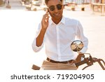 carefree african man in... | Shutterstock . vector #719204905
