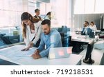portrait of architects having... | Shutterstock . vector #719218531
