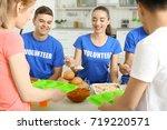 teen volunteers serving food... | Shutterstock . vector #719220571