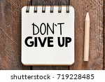 don t give up word written in... | Shutterstock . vector #719228485