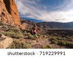 trail running woman in... | Shutterstock . vector #719229991