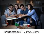 friends watching tv in evening... | Shutterstock . vector #719233591