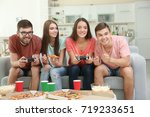 friends playing video games on... | Shutterstock . vector #719233651