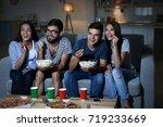 friends watching tv in evening... | Shutterstock . vector #719233669