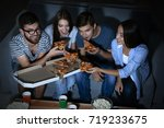 friends watching tv in evening... | Shutterstock . vector #719233675